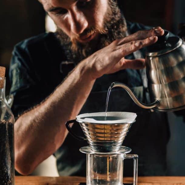 barista making calita drip brew coffee 6YS7MED