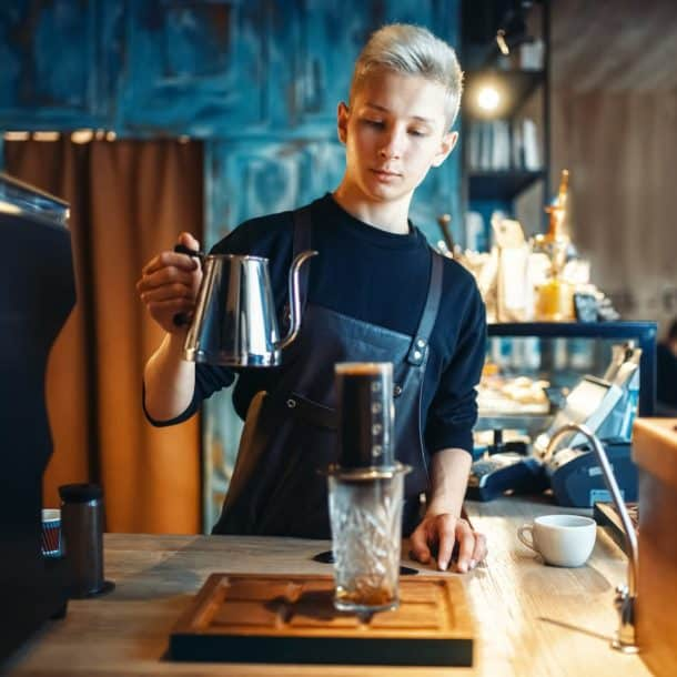 Barista Pours Water From Coffee Pot