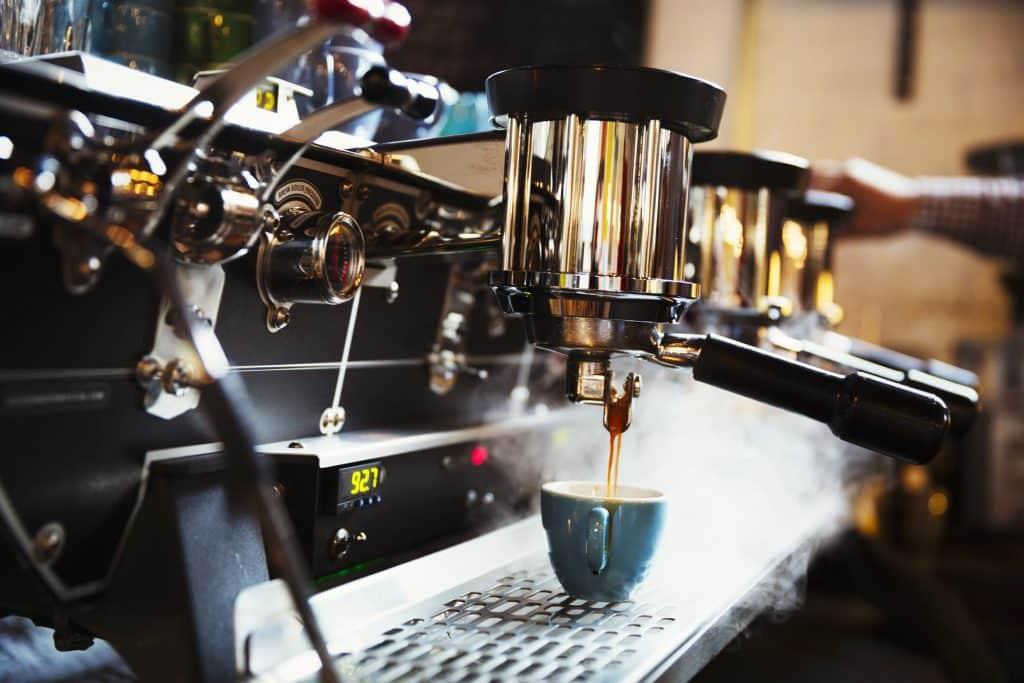 specialist coffee shop a coffee machine making cof 9MBLGQ6