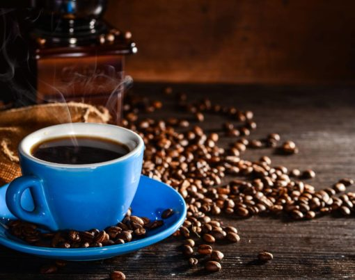 cup-coffee-with-coffee-beans-grinder-background